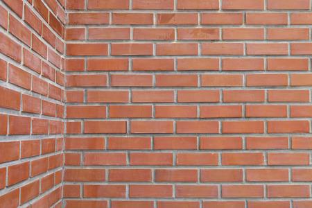 Outdoor red brick wall corner background, a horizontal photo, Archivio Fotografico