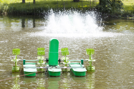 aerator: Aerator floated on water surface oxygen blenders water treatment Stock Photo
