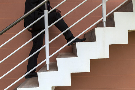 surmount: businessman hurry going up on stair Stock Photo