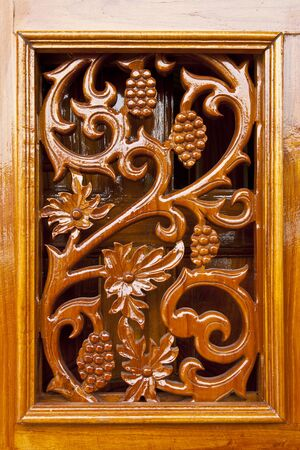 lacquer: Thai plant carved pattern on lacquer wooden door
