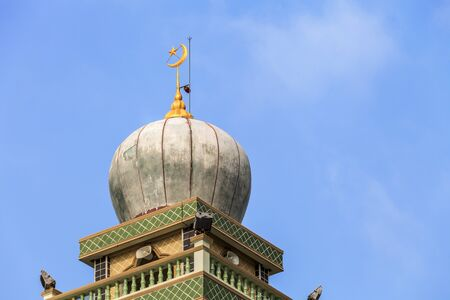 Muslim Islamic mosque tower on blue sky background at Phatong beach, Phuket, Thailand