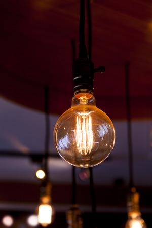 tungsten: zigzag heated filament tungsten lamps on dark background