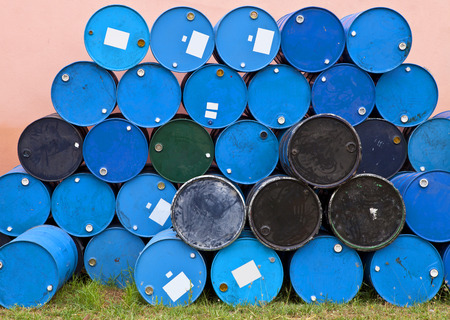 gass: Blue barrels or tanks on grass. oil container, oil barrels