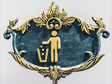 vintage green and gold sign for putting garbage to the bin