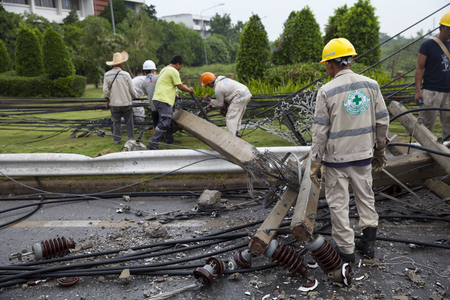 vocational: MUENG, MAHA SARAKHAMTHAILAND MAY 2015: Electrical engineers are salvaging the wreckage of a high-voltage pylons due to heavy rain disaster on May 12, 2015 in Maha Sarakham. Near Vocational college.