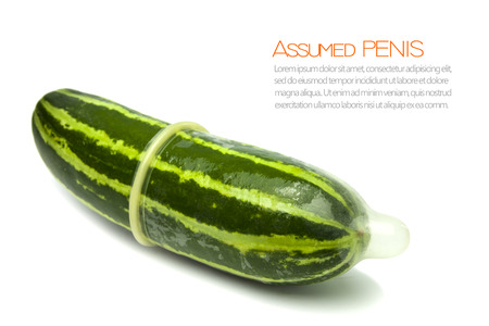 Assumed penis for education using the green cucumber and condom isolated on white background 免版税图像