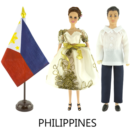 modest fashion: philippinse national dress for man and woman wered on dolls and the desktop philippinse nation flag isolated on white background