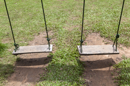 doublet: two rope swings on green grass background, playground Stock Photo