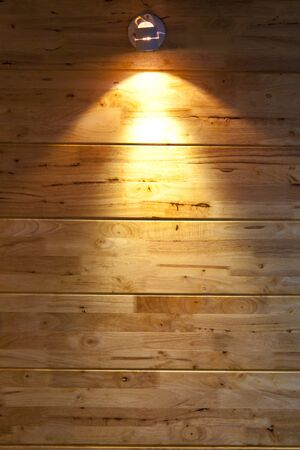 interior lighting: interior room with wood wall under lighting lamp Stock Photo