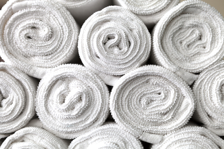 washup: rolled white body towels background Archivio Fotografico