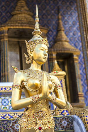 gardian: golden kinaree image act like sawasdee, myth animal, Thai art Stock Photo