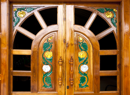lacquered: Asia carving style on wooden door, carv and paint pattern, lacquered coating
