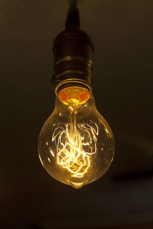 ingle glowing round bulb tungsten lamp
