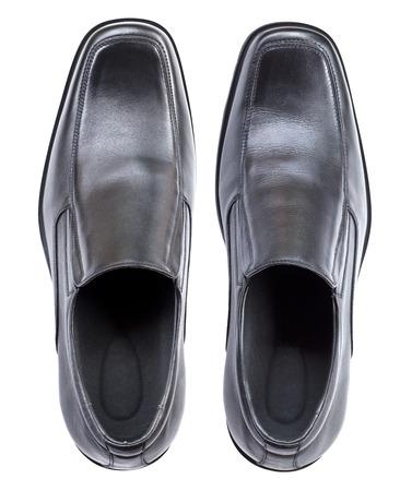 Zapatos de cuero negro moderno, sin cadena de zapatos, vista desde arriba aislados en fondo blanco Foto de archivo - 47341746