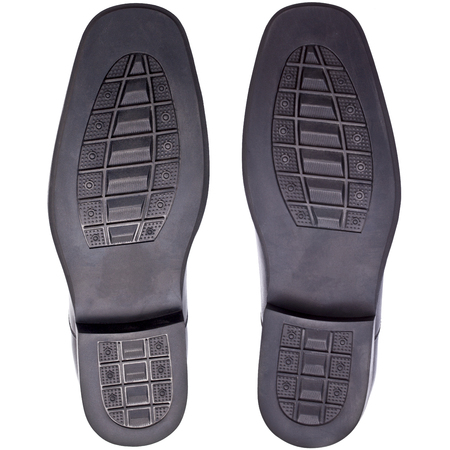 black rubber shoe soles of,male or men shoes, foot step, foot print, isolated on white blackground 免版税图像