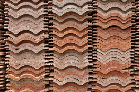 roof house: stack of red roof tiles, waving tiles, stock pile, stored, cross section