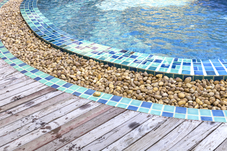 beautiful swimming pool decorated by round cobbles for drainage
