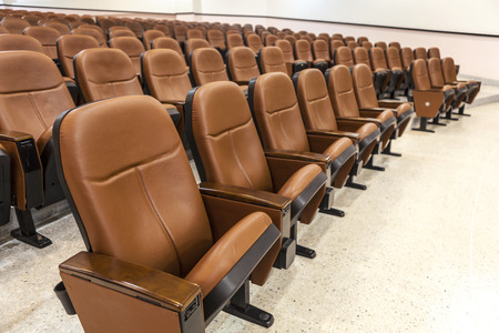 brown leather seats in rows, new condition chairs 免版税图像