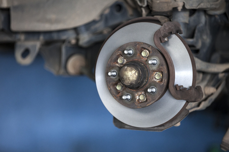 rusting: car wheel hub, disc, plate, rusted rotor, rusting bearing, used