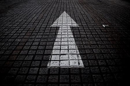 black block: White arrow forward on black block street.signs.