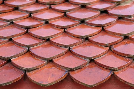 Antique tile roof Terrific textured tiles, antique clay tiles on the roof. Geometric shapes Stok Fotoğraf