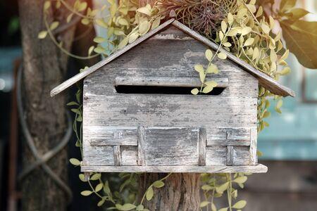wooden mailbox in flower garden,  vintage tone Stok Fotoğraf