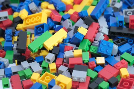 Colored toy bricks with the place