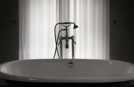 safty: curtain,interior,room,white bathtub,black and white,water,alone,sexy,curtain,dark room,relax,privacy,safty,restricted areas Stock Photo