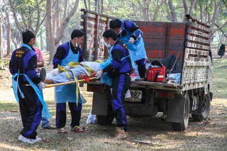 rigidity: Emergency Medical team lifting traumatic patient Editorial