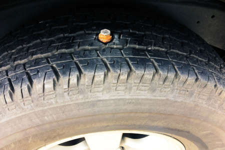 close up Bolts embedded Tires Cause of tire leakage