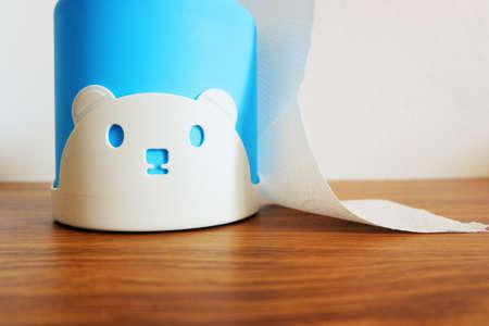 cute Tissue paper box of bear doll on wood desk