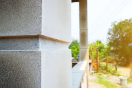 cement pole shape at front house with design construction Have a groove 写真素材