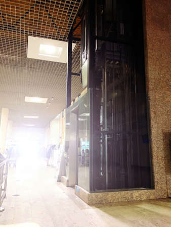 clear glass Elevator is Used within airport Building For passengers and staff