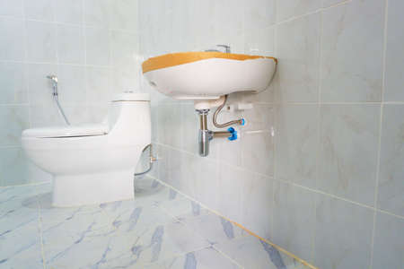 Installation of sanitary ware and valves in bathroom