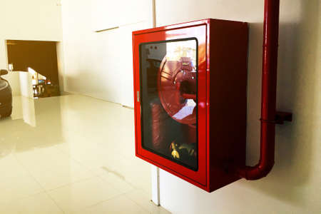 Cabinet on the wall for keep fire extinguishers Equipment of car showroom
