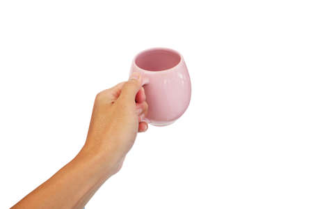 pink Ceramic Mug with holding in hand of Asian man isolated on white background