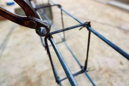 Using pliers for Bundle of iron With steel wire For building structures Of pouring Poles and beams Stock Photo