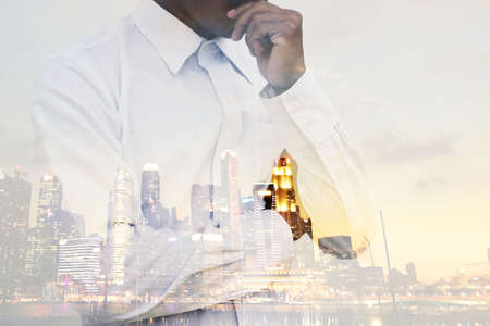 businessman is show gesture ruminate and dismal In terms of investment in the city.
