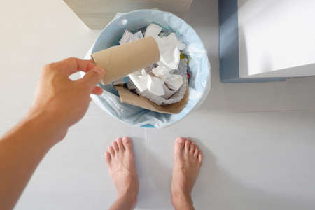 top view of hand is catch Paper Tissue for take to garbage bin in house Archivio Fotografico