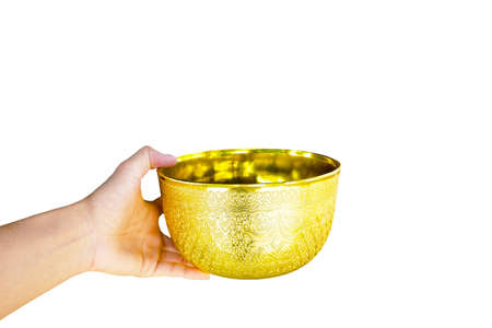 gold bowl in hand of man is reach out for give isolated on white background