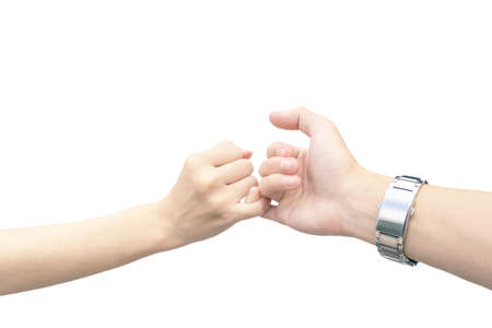 hand of man and woman are hook each other's little finger isolated on white background