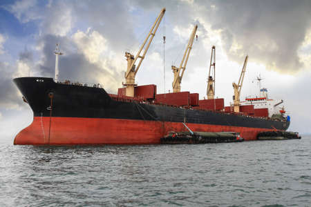 large cargo ship unloading containers, thailand