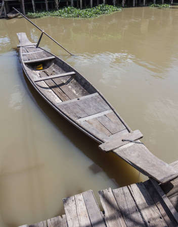 The Wooden boat on the river photo
