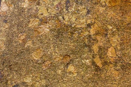 Golden Plate, Gold paper texture on Buddha sculpture photo