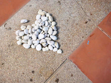 Stones were arranged in a heart shape on ground Imagens