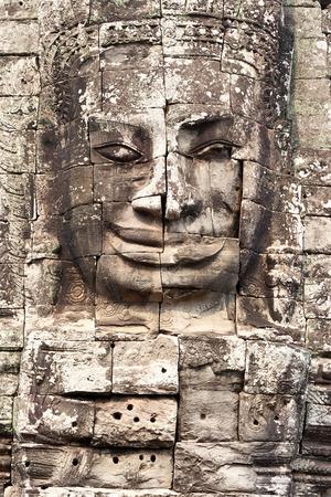 Bodhisattva face in Bayon temple at Angkor Thom photo