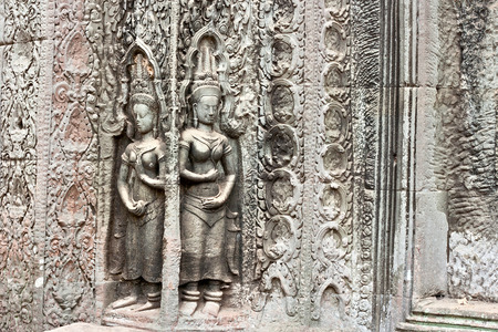 Stone carving Apsara in Ta Prohm temple at cambodia photo