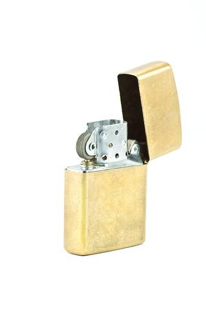 butane: Brass metal lighter isolated