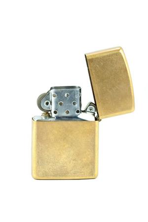 Brass metal zippo lighter isolated