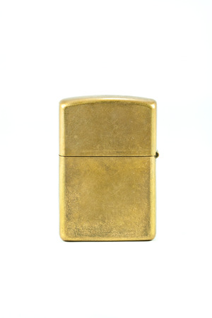 Brass metal lighter isolated on white background  Stock Photo - 29591623